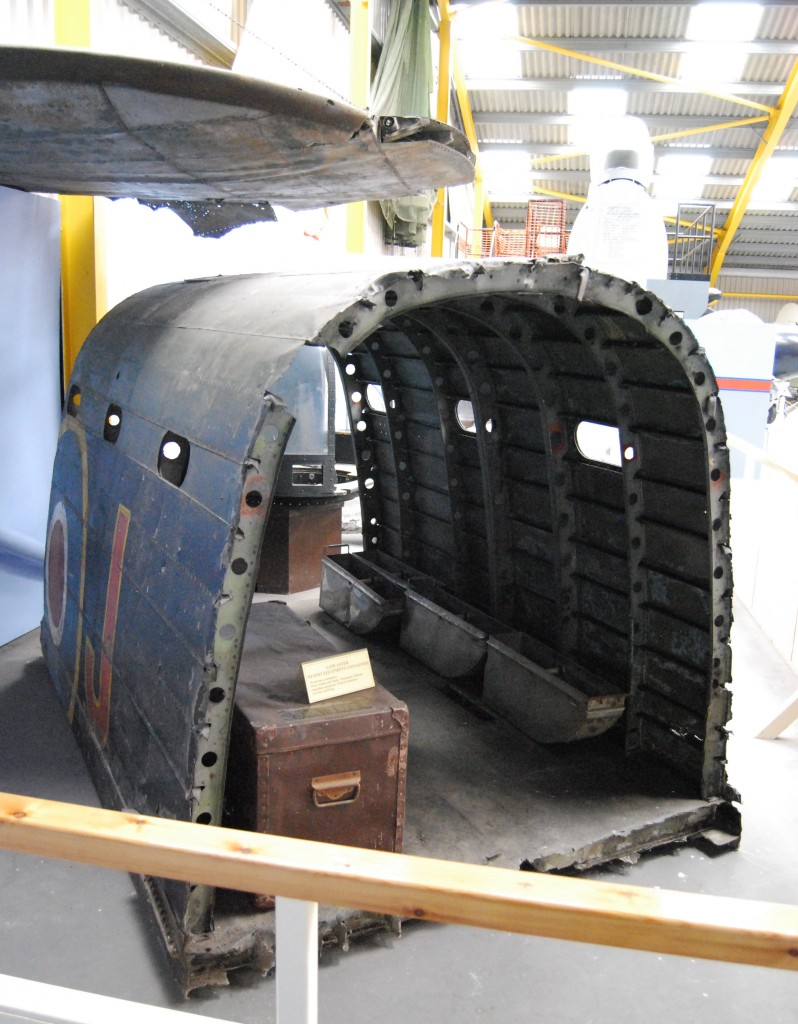 Newark Air Museum:  Lancaster Corner – (above) wing-tip of Lancaster bomber, R5726;  (foreground) fuselage fragment of Lancaster Mk I, W4964